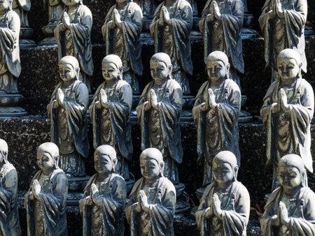 Komatsushima, Japan - April 4, 2018: Buddhist statues on the grounds of Onzanji, temple number 18 of Shikoku pilgrimage