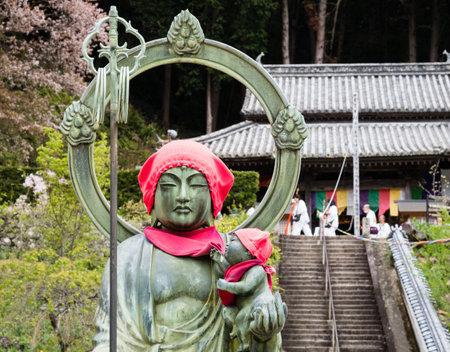 Anan, Tokushima prefecture, Japan - April 5, 2018: Jizo statue on the grounds of Byodoji, temple number 22 of Shikoku pilgrimage