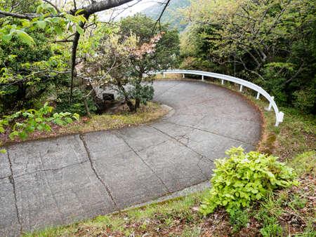 Narrow winding mountain road leading to Konomineji, temple number 27 of Shikoku pilgrimage - Kochi prefecture, Japan