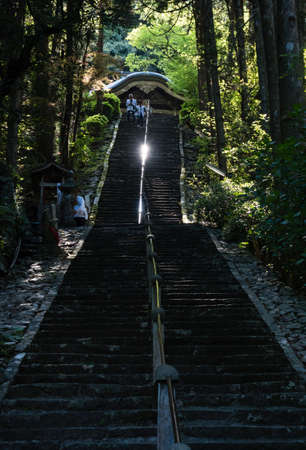 Tosa, Kochi Prefecture, Japan - April 7, 2018: Long flight of steep stairs leading to the main hall of Shoryuji, temple number 36 of Shikoku pilgrimage Editorial