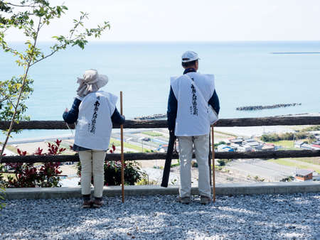 Kochi, Japan - April 7, 2018: Pilgrims admiring the view of Kochi coastline from Zenjibuji, temple number 32 of Shikoku pilgrimage