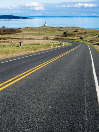 Scenic road leading to Cattle Point Lighthouse - San Juan Island, WA, USA