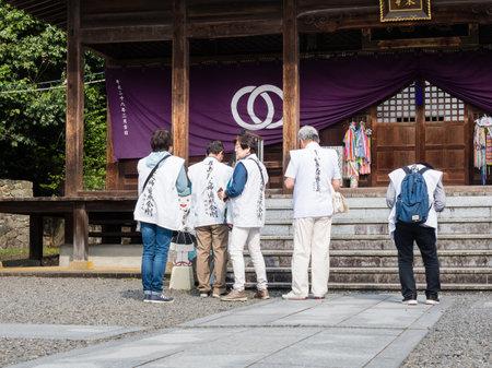 Matsuyama, Ehime prefecture, Japan - April 10, 2018: O-henro Buddhist pilgrims at Hantaji, temple number 50 of Shikoku pilgrimage Redakční