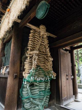 Matsuyama, Ehime prefecture, Japan - April 10, 2018: Buddha sandals in the gates of Ishiteji, temple number 51 of Shikoku pilgrimage