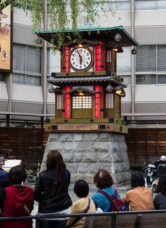 Matsuyama, Ehime prefecture, Japan - April 10, 2018: Visitors waiting for scheduled performance of Botchan Karakuri Clock in Dogo Onsen