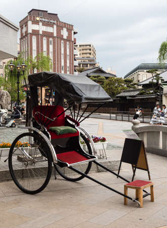 Matsuyama, Ehime prefecture, Japan - April 10, 2018: Rickshaw pull cart at Dogo Onsen station