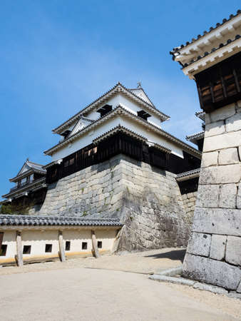 Matsuyama, Ehime prefecture, Japan - April 11, 2018: Entrance to the main tower of historic Matsuyama Castle, one of 12 original castles of Japan