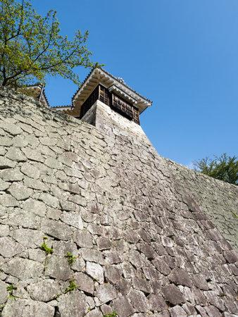 Matsuyama, Ehime prefecture, Japan - April 11, 2018: Steep stone walls of historic Matsuyama Castle