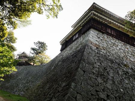 Matsuyama, Ehime prefecture, Japan - April 11, 2018: Steep stone walls and towers of historic Matsuyama Castle