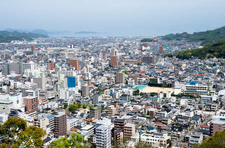 Matsuyama, Ehime prefecture, Japan - April 11, 2018: Panoramic city view from the top of Matsuyama Castle