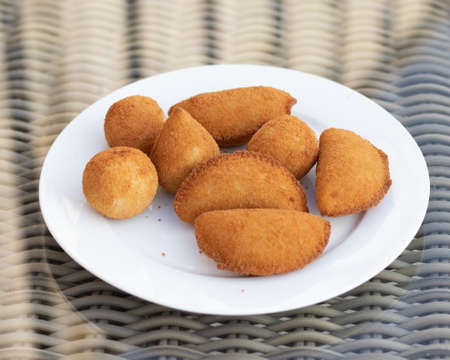 Salgados Brazilian fried snacks, party finger food fried snack, stuffed with chicken, cheese, corn