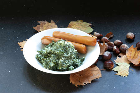 Typical European fall and winter food, Mash pot of potatoes and vegetables, kale and sausage
