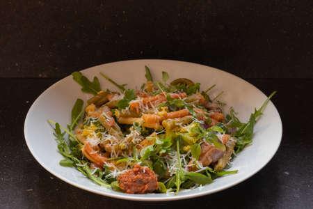 Rucola with caserecce tricolor, pasta with broccoli, red pesto & grana padano