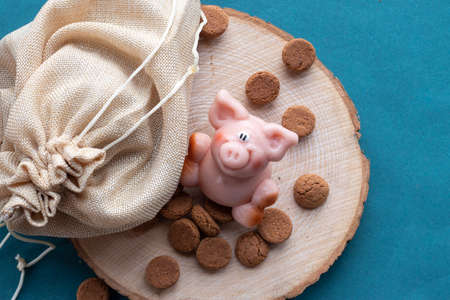 Pink marzipan pig with many pepernoten cookies