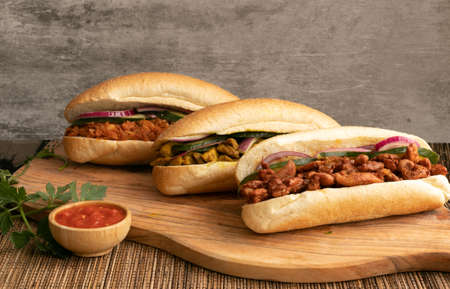 Indian Surinamese sandwiches filled with roti chicken curry, cod fish or tandoori chicken Stockfoto