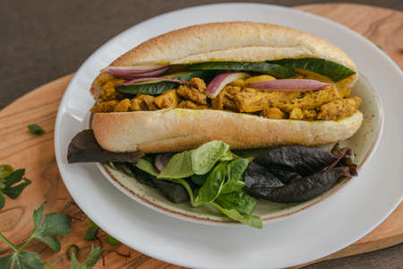 chicken curry Sandwich with salad