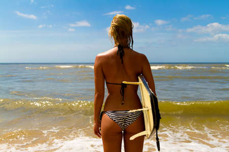 Woman with surf photo
