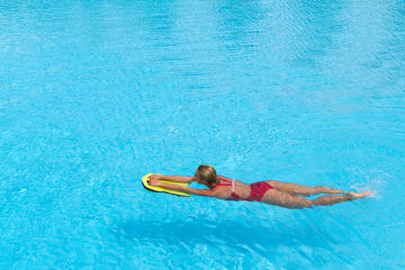 polyfoam: aqua aerobic. Swimmer during practice with board from polyfoam for swimming