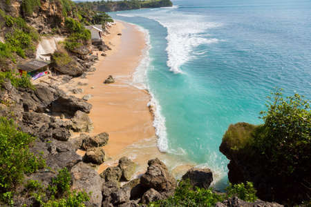 view of the beautiful beach where people are surfing in water. Bali. Balangan photo