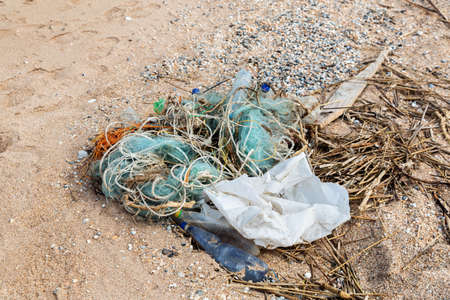 plastic pollution: Pollution: garbages, plastic, and wastes on the beach after winter storms.  Stock Photo