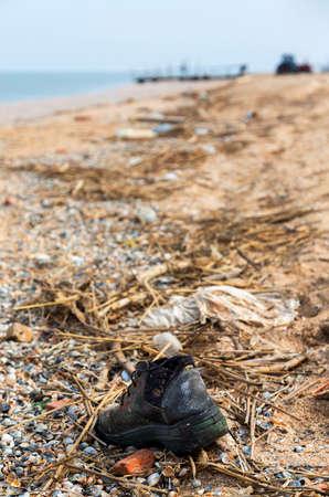azov sea: Pollution: shoes at Azov sea.  Stock Photo