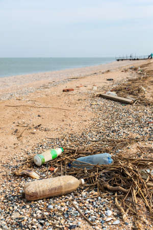 wastes: Pollution: garbages, plastic, and wastes on the beach after winter storms. Stock Photo