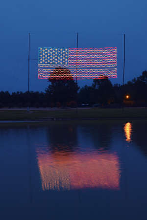 middle america: Electric American Flag at Night in Plains Georgia, home of 39th President of the US, President Carter
