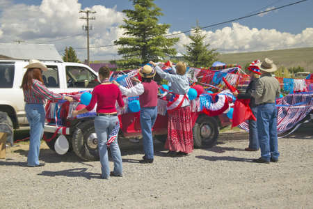 Group decorating a car in red, white & blue in Lima Montana Stock Photo - 19962404