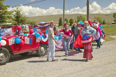 Group decorating a car in red, white & blue in Lima Montana Stock Photo - 19962141