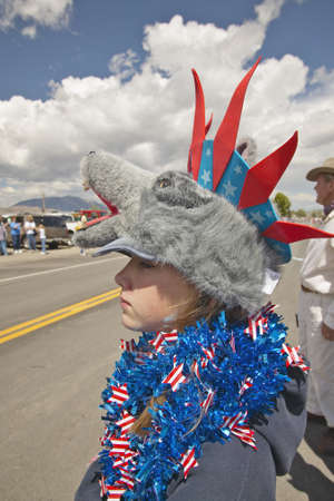 Child wearing unusual headgear for the Fourth of July Parade, in Lima Montana Stock Photo - 19962305