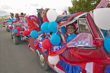Cars decorated in red, white & blue for Independence Day Parade, in Lima Montana