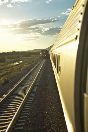 arizona sunset: Passenger train traveling into the Arizona sunset