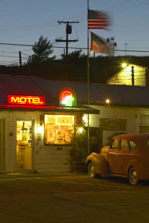 Route 66 neon sign and historic vintage roadside motel welcomes old cars and guests in Barstow California Stock Photo - 19962198