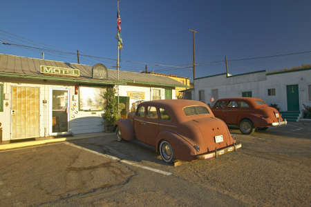 Historic vintage roadside motel on old Route 66 welcomes old cars and guests in Barstow California Stock Photo - 19962402