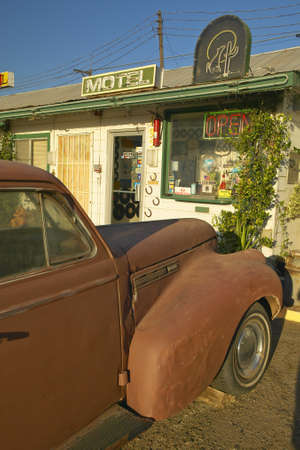 barstow: Historic vintage roadside motel on old Route 66 welcomes old cars and guests in Barstow California Editorial