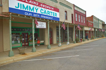 exclaiming: Storefront with banner exclaiming Plains Georgia to be the home of Jimmy Carter, our 39th President in Plains, Georgia Editorial