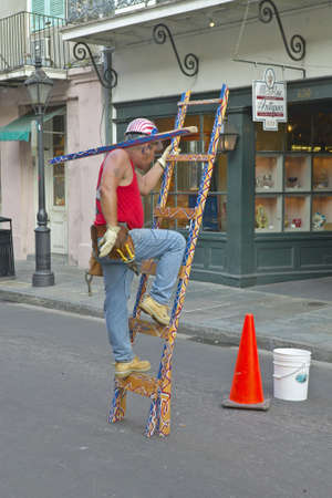 performs: Bourbon Street area mime artist performs in French Quarter of New Orleans, Louisiana Editorial