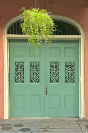unspecified: Old freshly painted doors in French Quarter near Bourbon Street in New Orleans, Louisiana Stock Photo