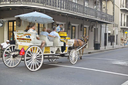 Horse Carriage and tourists in French Quarter of New Orleans, Louisiana Stock Photo - 19962333