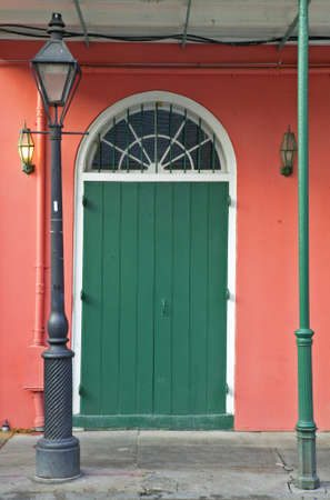 the deep south: Old freshly painted doors in French Quarter near Bourbon Street in New Orleans, Louisiana Stock Photo