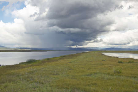 Storm clouds over grasslands and mountains at Red Rock Lake in Centennial Valley, near Lakeview, MT photo