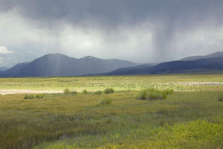 lakeview: Storm clouds over grasslands and mountains at Red Rock Lake in Centennial Valley, near Lakeview, MT