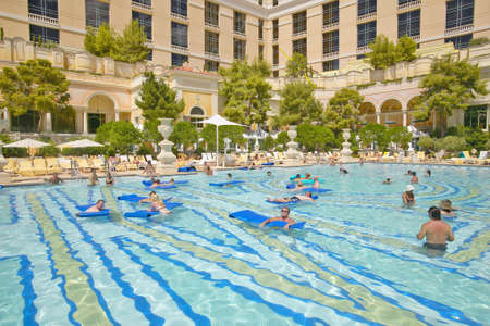 Large swimming pool with swimmers at Bellagio Casino in Las Vegas, NV