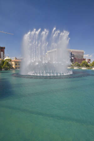 nv: Water fountain display at Bellagio Casino with Paris Casino and Eiffel Tower in Las Vegas, NV