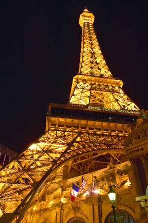nv: Vertical night view of Eiffel Tower at Paris Casino, Las Vegas, NV Editorial