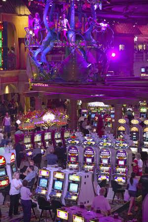 nv: Rows of slot machines and gamblers at Rio Casino in Las Vegas, NV Editorial
