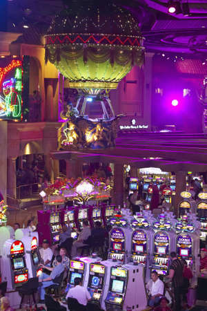 nv: Rows of slot machines and gamblers at Rio Casino in Las Vegas, NV Editorial