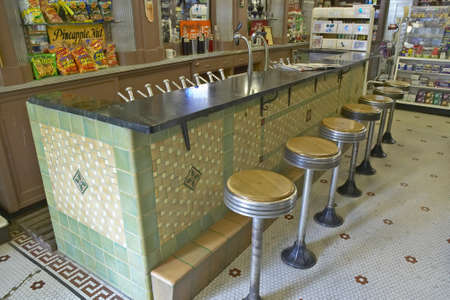 barstools: Interior of old drug store with bar stools and soda fountain in French Quarter of New Orleans LA
