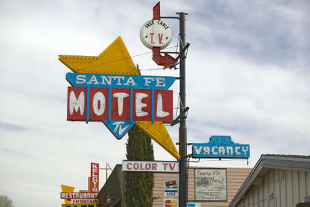 advertise with us: A 1950s style neon sign in the daytime reads ÒSanta Fe Motel with color TVÓ in Tehachapi, California