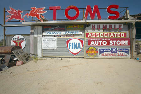 barstow: Old antique gas signs of on automobile shop near Barstow, CA off of Route 58